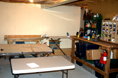 Here's two of the worktables, ironing board and empty (yeah!) tables